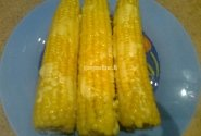Virti kukurūzai su sviestu ir sūriu